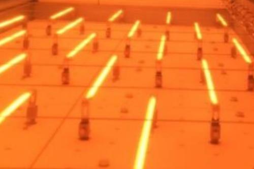 Chauffage par infrarouge des tissus à déposer dans le moule